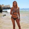 Presentatrice in bikini van Agua Bendita